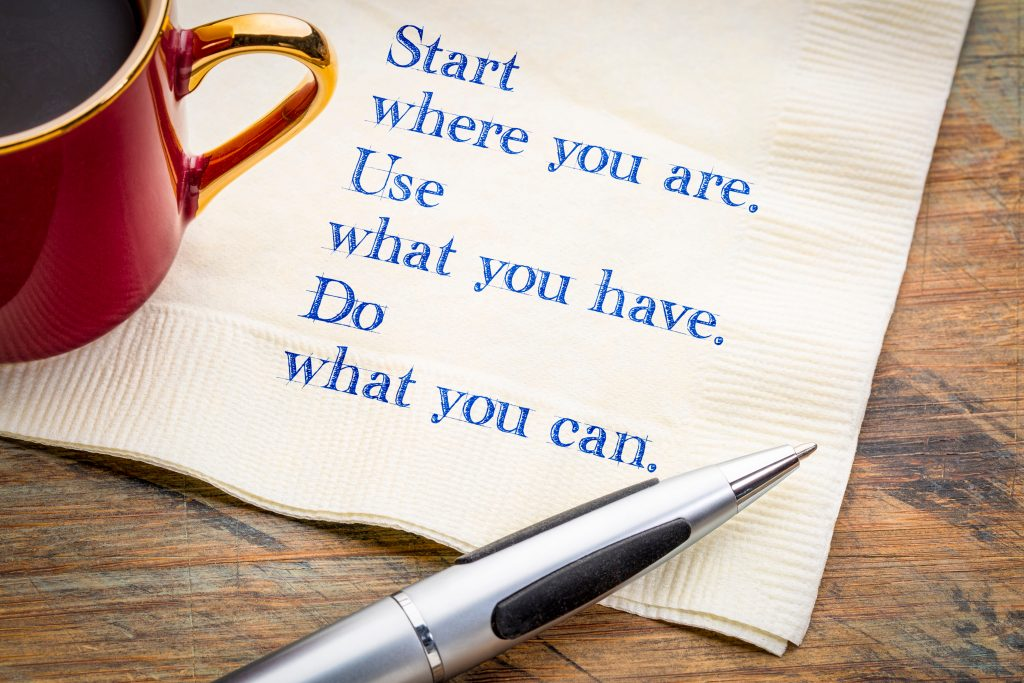 """Picture of a coffee cup with a napkin underneath it. The words printed on the napkin are Start where you are. use what you have. Do what you can. This page seeks to answer the question """"how do i become a foster carer?"""""""